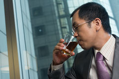 Drinking a glass of whisky Stock Images