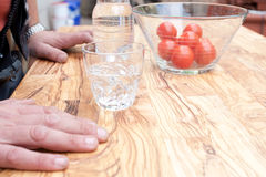 Drinking glass on wooden table Stock Images