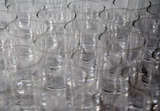 Drinking glasses. A closeup view overlooking the tops of drinking or beverage glasses Royalty Free Stock Image