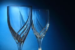 Drinking Glasses on Blue Background Stock Photography