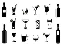 Drinking glasses and bottles Stock Image