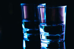 Drinking glasses close-up on a dark background Stock Photography
