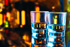Drinking glasses close-up on a dark background Royalty Free Stock Photos