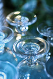 Drinking Glasses Closeup. Closeup of drinking glasses against a blurred background stock photography
