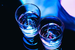 Drinking glasses with ice close-up on a dark background Royalty Free Stock Photo