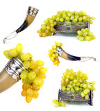 Drinking horn and fruit bowl of grapes Royalty Free Stock Photo