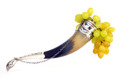 Drinking horn and grapes on white Royalty Free Stock Photo