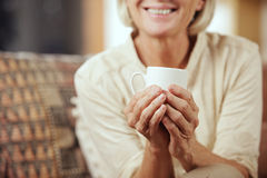 Drinking hot beverage Royalty Free Stock Image