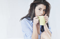 Drinking hot coffee Royalty Free Stock Photos