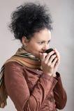 Drinking hot coffee Stock Image