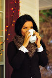 Drinking hot tea on a cool autumn day. Young woman drinking hot tea outdoors in the autumn Stock Image