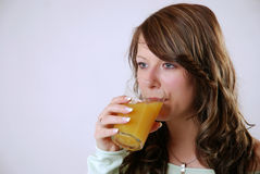 Drinking juice Royalty Free Stock Photo