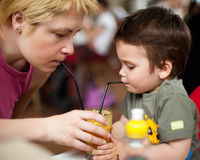Drinking juice Royalty Free Stock Images