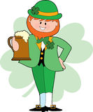 Drinking Leprechaun. Irish Leprechaun making a toast with a beer Royalty Free Stock Photos