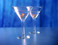 Drinking Like a Fish. Two Martini's garnished with goldfish swimming royalty free stock image