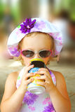 Drinking Little Girl. Royalty Free Stock Image