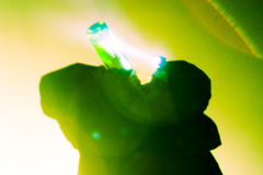 Drinking man. Silhouette of man drinking, shot backlit, visible lens flare Royalty Free Stock Photos