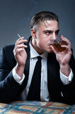 Drinking man with cigarette Stock Image