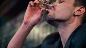 Drinking man in the club. Vodka or water stock video footage
