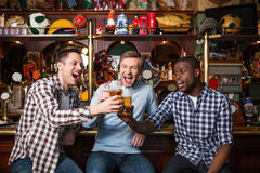 Drinking man. Smiling fans with a beer Royalty Free Stock Image