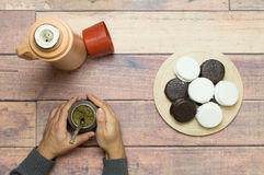 Drinking mate with alfajores on the table stock images