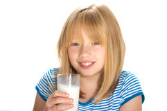 Drinking Milk. Young girl drinking a glass of milk Royalty Free Stock Image