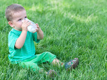 Drinking milk on the grass Stock Photos