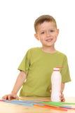 Drinking milk/jogurt. Five years old boy drinking milk isolated on white royalty free stock photos