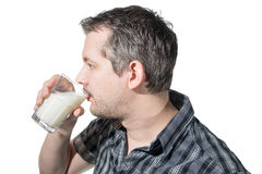 Drinking milk in profile Stock Image