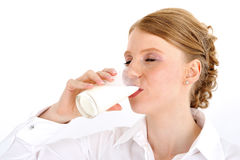 Drinking milk. Red haired woman drinking a glass of milk Stock Photography