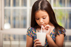 Drinking milk with a straw Royalty Free Stock Images
