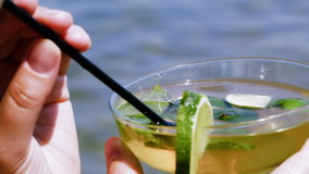 Drinking mojito with straw stock video