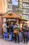 Drinking Mulled Wine. Colmar,France-December 6,2013: People gathered near a stall for drinking mulled wine in a Christmas Maket in Colmar, Alsace on December 6 Stock Images