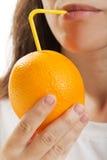 Drinking orange fruit stock photography