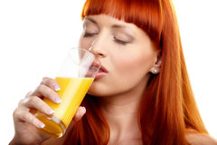 Drinking orange juice Stock Images