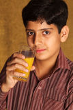 Drinking orange juice. Portrait of boy drinking orange juice stock photos