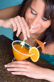 Drinking Orange juice Royalty Free Stock Photography