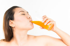 Drinking orange juice Royalty Free Stock Image