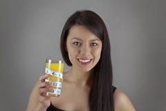 Drinking orange juice Stock Image
