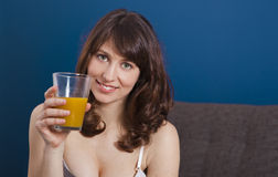 Drinking orange juice Royalty Free Stock Photos