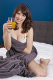 Drinking orange juice Royalty Free Stock Images