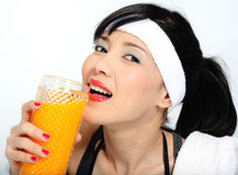 Drinking orange juice  after practicing sport Stock Photography