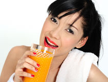 Drinking orange juice  after practicing sport Stock Photo