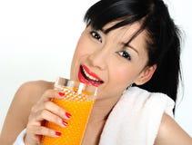 Drinking orange juice  after practicing sport Stock Photo