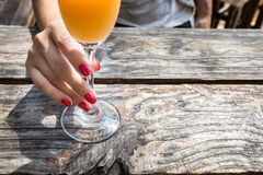 Drinking an orange juice Royalty Free Stock Photos