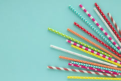 Drinking paper colorful straws for summer cocktails on light blue background. Drinking paper colorful straws for summer cocktails on light blue background with royalty free stock images