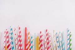 Drinking paper colorful straws for summer cocktails on white background with copy space. Top view. Drinking paper colorful straws for summer cocktails on white stock photography