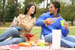 Drinking On Picnic. Getting ready to drink on summer picnic outdoor. concept for summer or outdoor royalty free stock photography