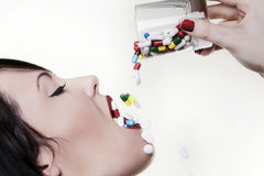 Drinking pills Stock Photography