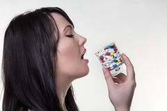 Drinking pills Royalty Free Stock Images